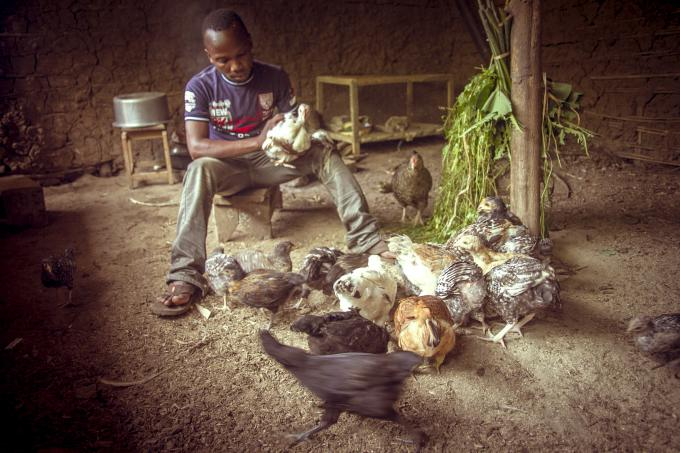 Charles Asera from Western Uganda engages in poultry to earn an income.