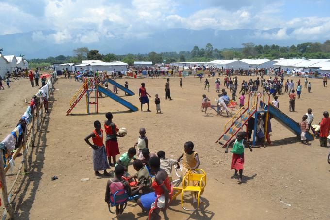 Children play in a child-friendly space run by Save the Children.