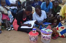 'The Bank in the Village': A village savings and loans association (Nayonae Agro-Pastoral Field School Group) during one of their meetings. The group was supported by KALIP funding through Food and Agricultural Organisation (FAO) in Kotido District.