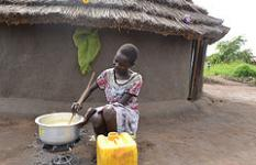 Khadija Bol,* 12, prepares porridge for her family in Baratuku refugee resettlement, Adjumani district, Uganda
