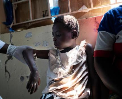 New report shows the shocking violence forcing children to flee to Uganda
