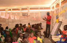 Deng teaches children in Save the Children's early childhood care and development centre.