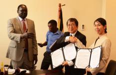 Japan Ambassador Kazuaki Kameda (centre) and Save the Children Japan's Mariko Fuwa after signing hte contract.