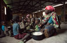 Mwavita and her children have a meal