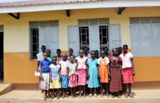 Pupils of Natigi Chance School outside their new classroom block.